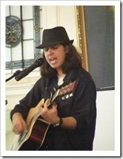 Tsoof Baras singing and playing guitar