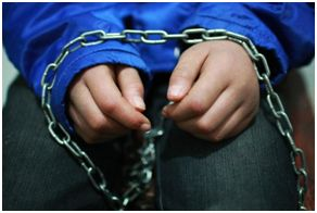Child's hands in chains. Teaching kids obedience is like emotional chaining