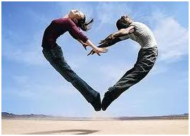 Couple jumping in the shape of a heart