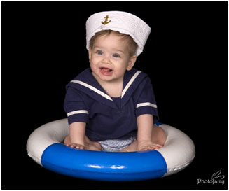Baby boy in a sailors hat sitting in a lifesaver float