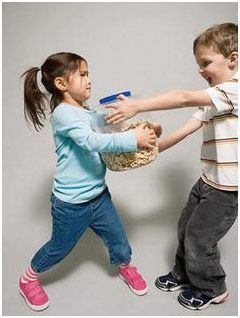 Boy and girl fighting over a jar