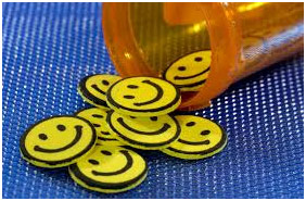 Smileys falling out of a pill box