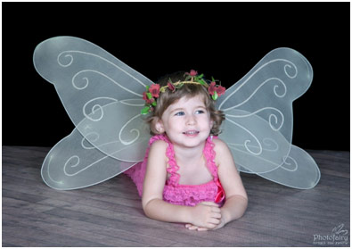 Little girl dressed up as a butterfly