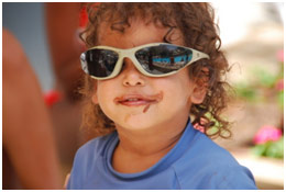 Little curly haired boy wearing sunglasses
