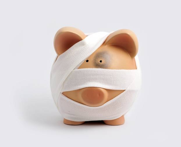 Bruised and bandaged Piggy Bank