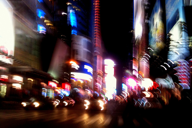 Blurred city street at night captured in movement