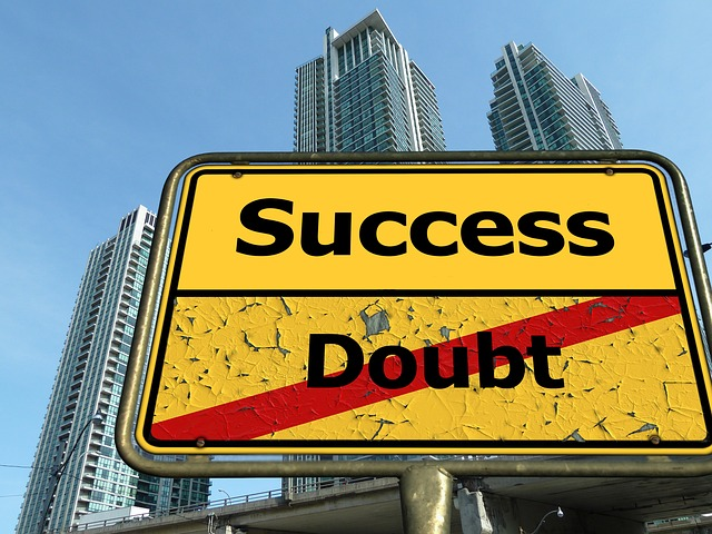 "Sign with ""success"" and ""doubt"" crossed out - beliefs about money make the difference"