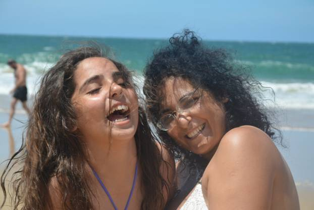 Ronit and Noff laughing on the beach