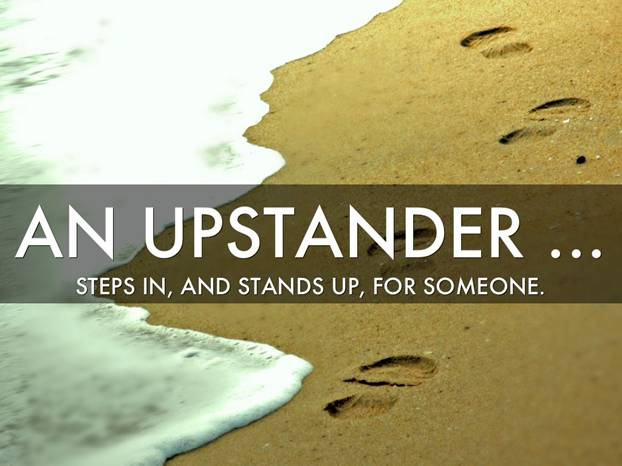 An upstander steps in, and stands up, for someone written over footsteps on the beach