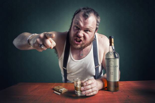 Angry man drinking alcohol
