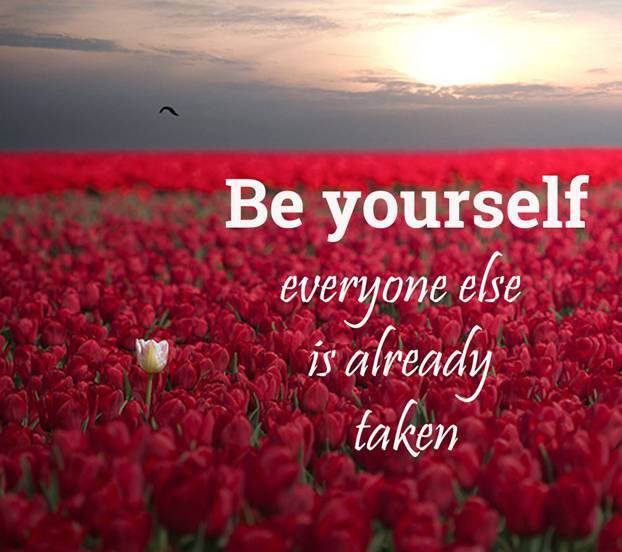Be yourself everyone else is already taken written over a field of red flowers with a white flower sticking out