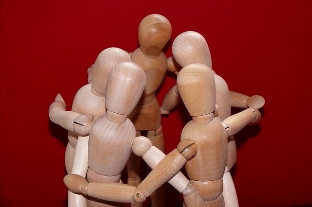 Wooden puppets in a huddle
