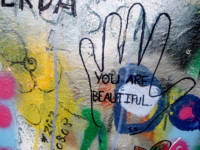 Hand print on glass with You Are Beautiful