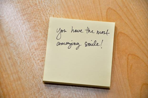 "Post it note with ""You have the most amazing smile!"""