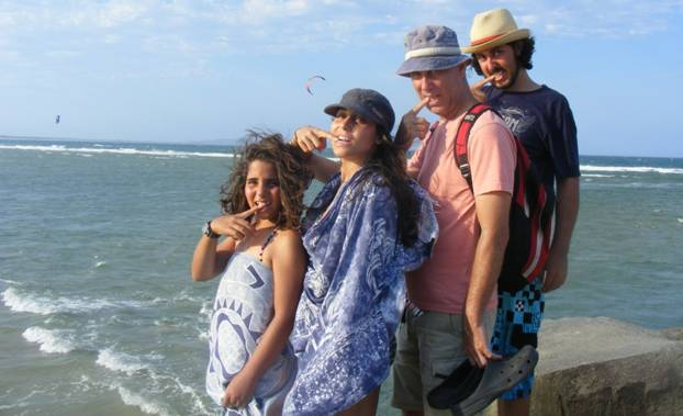 The Baras family in a funny pose on the beach