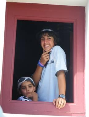 Tsoof and Noff peeking out through a window