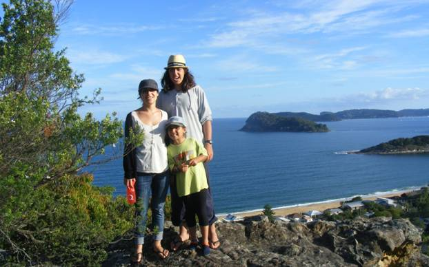 Our kids on a hill overlooking a bay