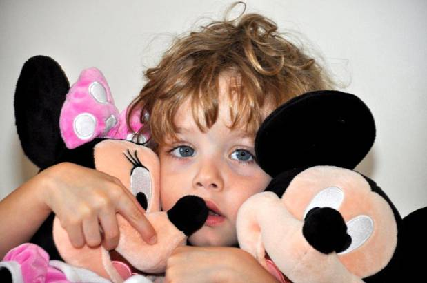 Baby with Mickey and Minnie Mouse dolls