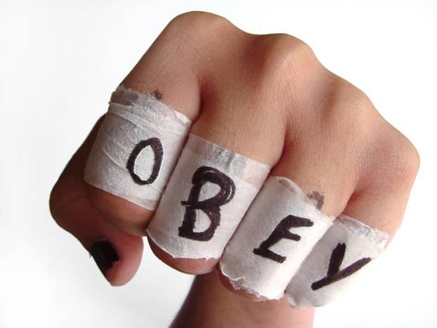 OBEY written on knuckles