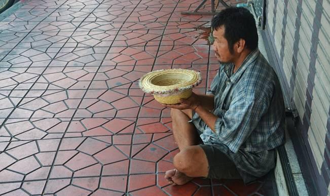 An Asian street beggar