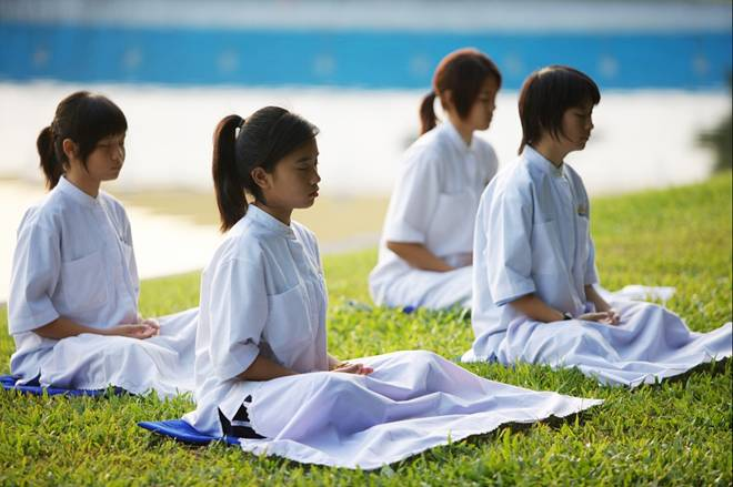 Young Buddhist girls meditating