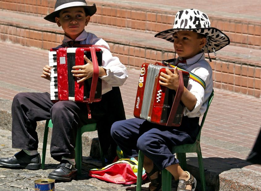 2 your boys playing accordion on the street