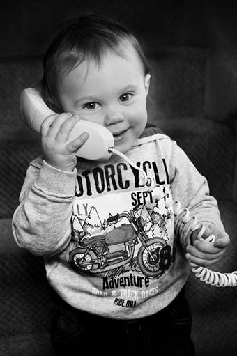 Baby talking on the phone - a sign he may be auditory