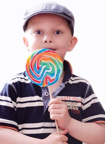 Boy holding a large round candy