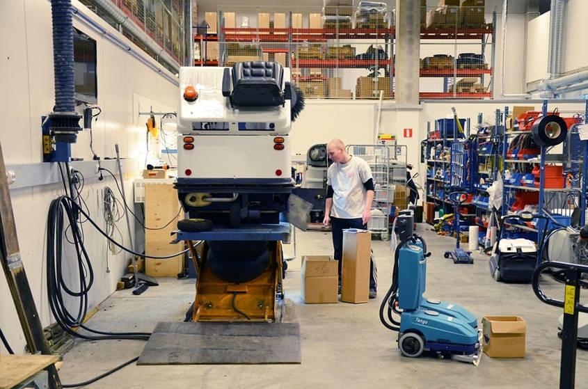 Teenage boy in a machine workshop