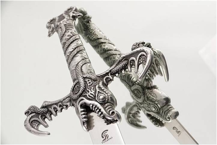 Sword with dragon hilt reflected in the mirror