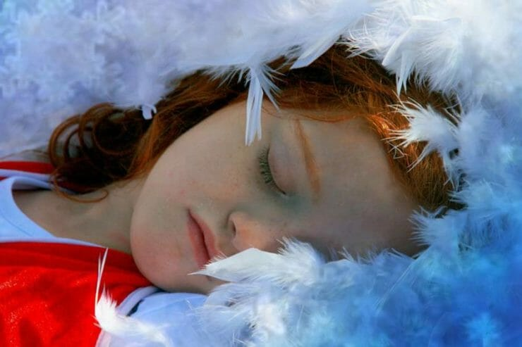 Girl sleeping on feathers