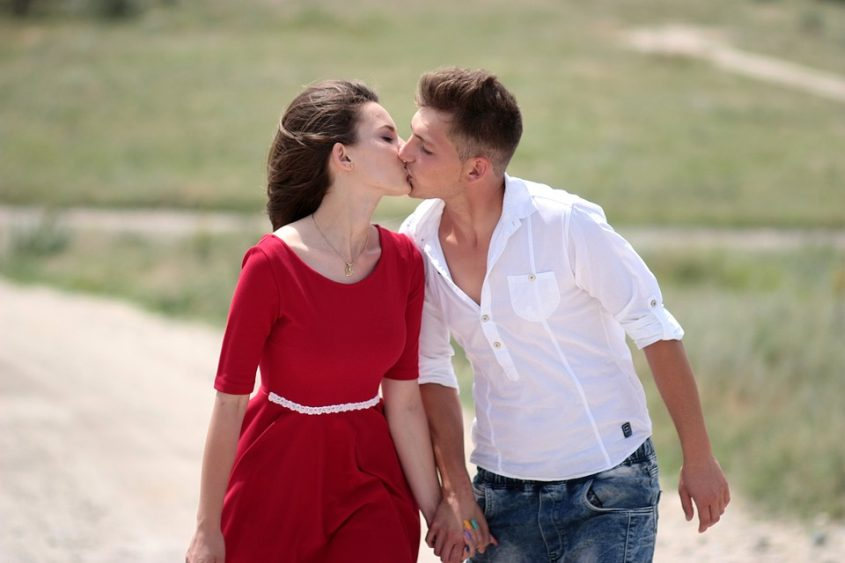 Couple kissing on a country road