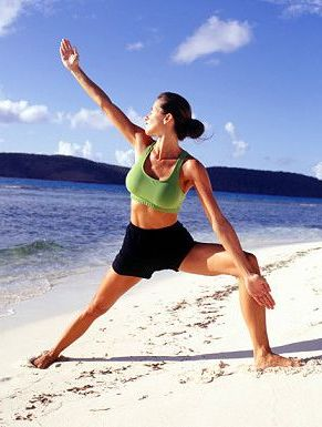 Woman stretching on a beach