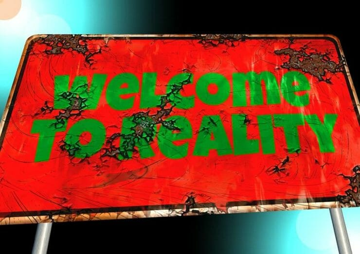 Rusty sign saying Welcome to Reality