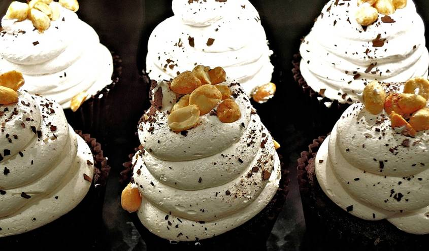 Cupcakes with whipped cream and peanuts on top