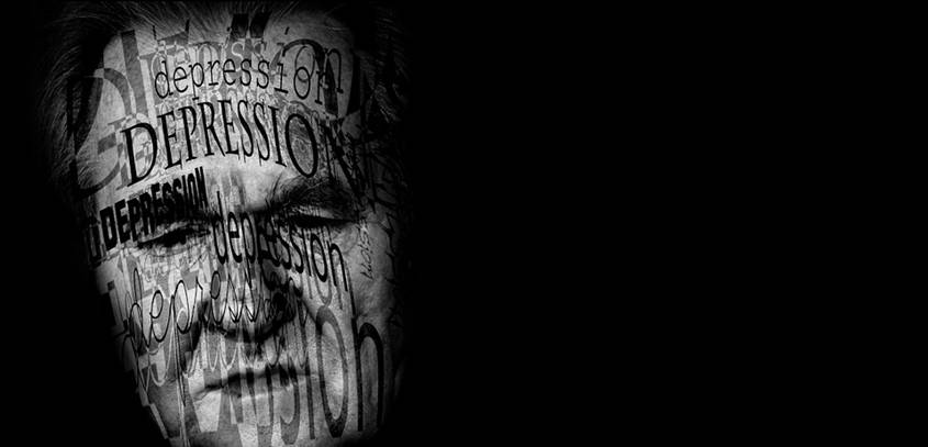 The word depression projected onto a sad man's face