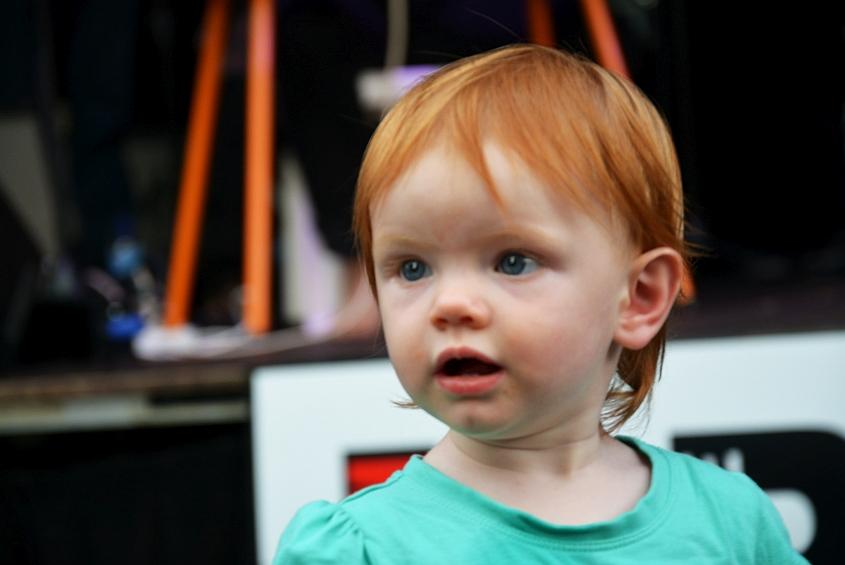 Toddler girl looking curious