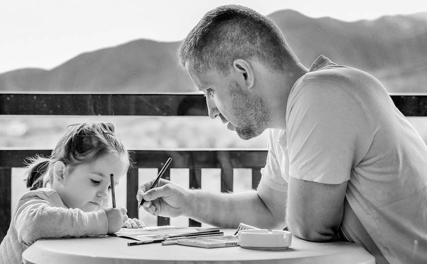Father, daughter and a workbook