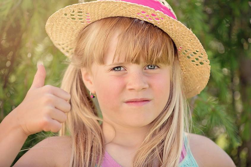 Girl looking worried while giving the thumbs up
