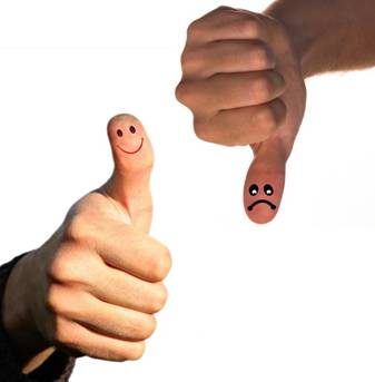 Smiling face on thumb up and sad face on thumb down