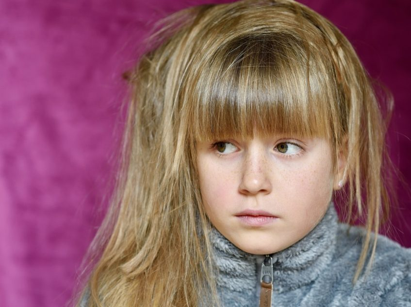 Girl with disheveled hair looking worried