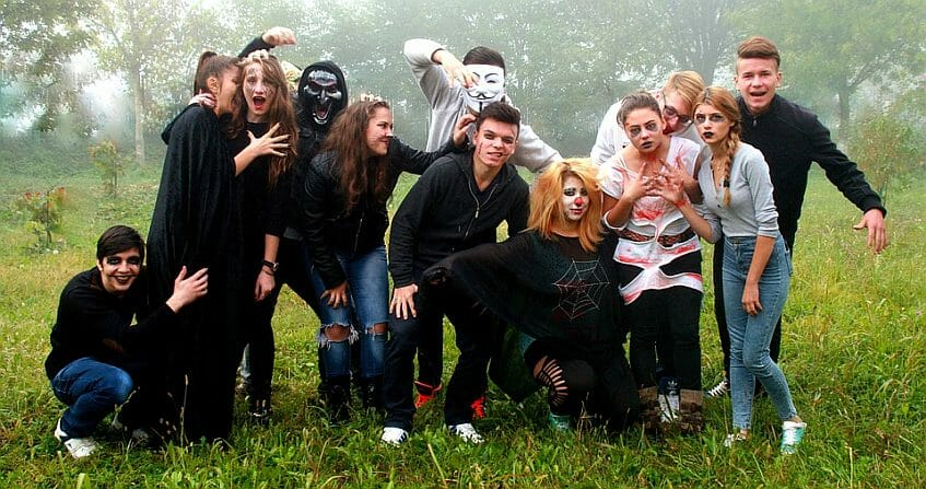 A group of teenagers on Halloween costumes