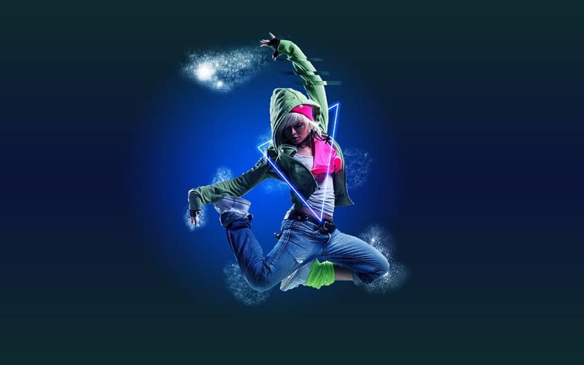 Teen girl jumping in the air in hip-hop outfit