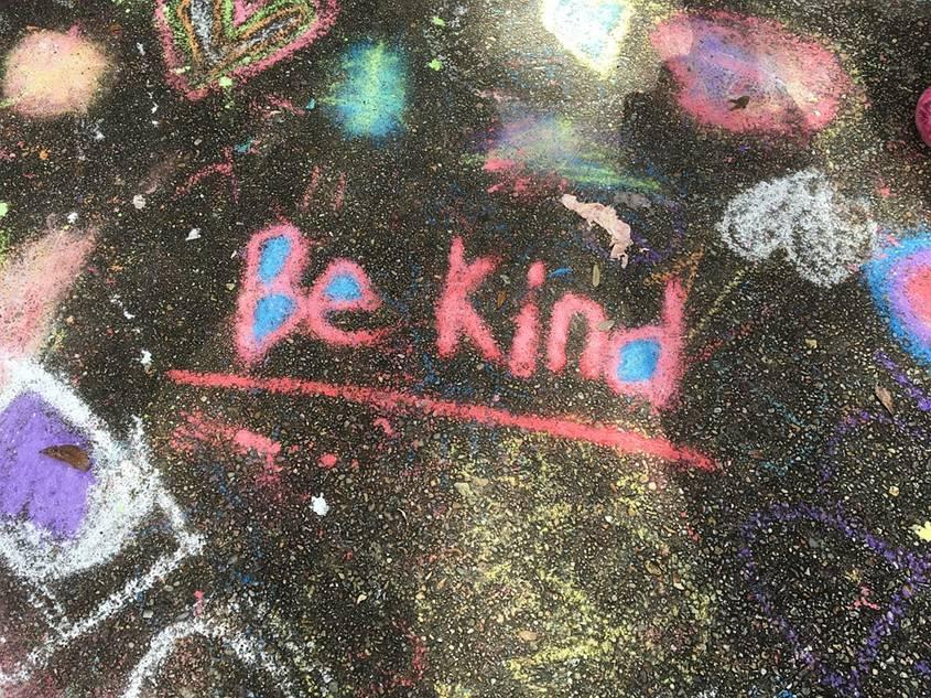 Be Kind written on a messy board
