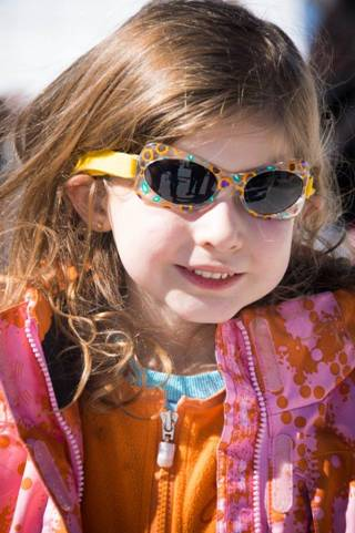 Girl with sunglasses and snow suit