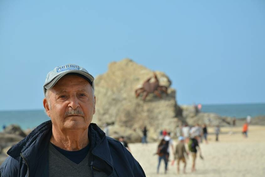 Old man on a beach