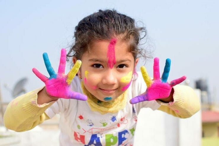 Girl with painted face and hands