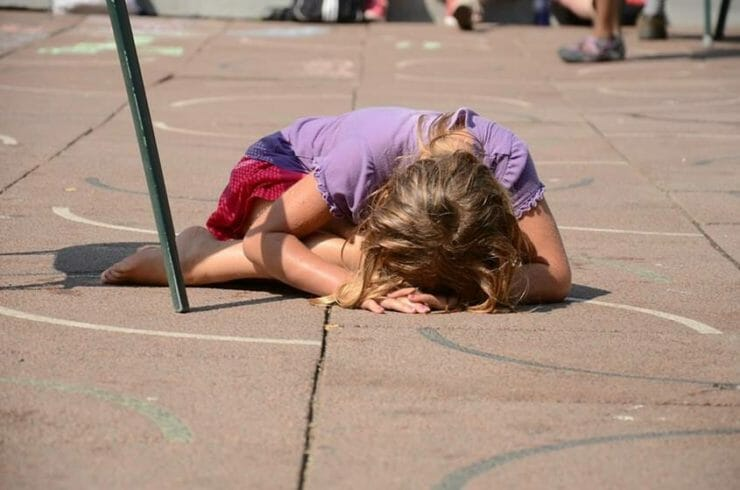Autistic girl on the ground at school