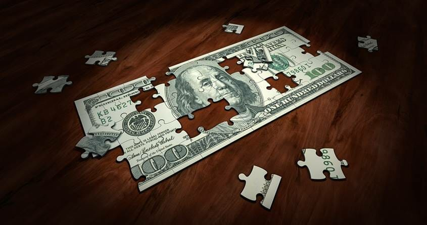 A jigsaw puzzle of a $100 bill - wealth creation is like solving a puzzle