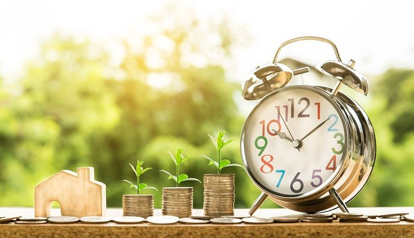 Home, stacks of coins and a clock - that's how wealth is built